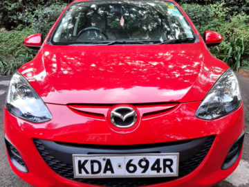 Shiny red clean Mazda Demio!