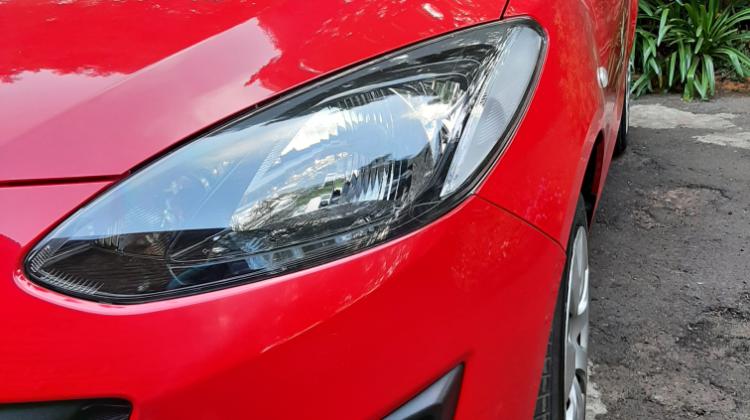 Shiny red clean Mazda Demio!